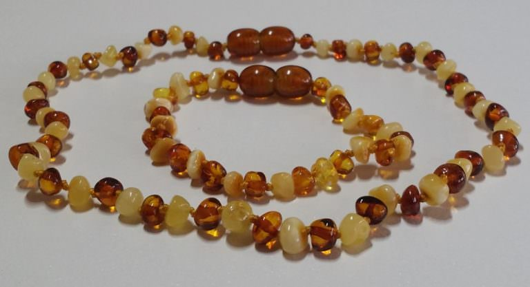 white cognac amber teething sets